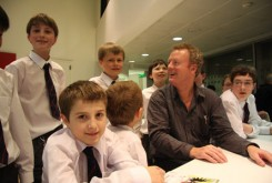 Howard with pupils from Guildford County School